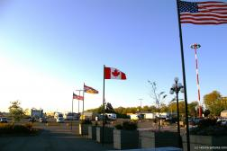 US and Canadian flags at the Victoria cruise port.jpg