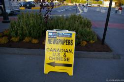 Newspaper sign at the Victoria cruise harbor.jpg