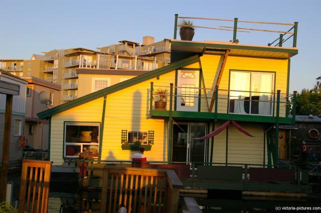 Yellow two level floating home at Victoria Fisherman's Wharf.jpg
