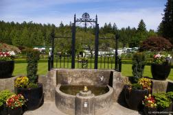 Fountain near rose garden at the Butchart Gardens.jpg