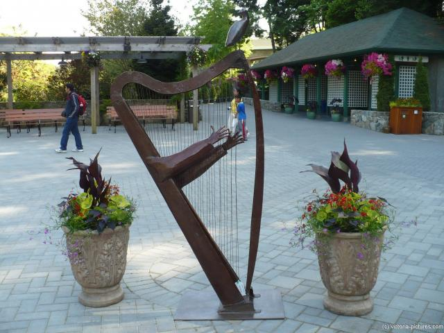 Harp statue art at the Potted plant and floral arrangement at the Butchart Gardens in Victoria.jpg