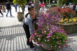 Joann and flowers at Butchart Gardens entrance area.jpg