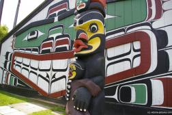 Totem tole with big lipped spirit at the totem pole park in Victoria.jpg
