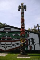 Totem pole with thunderbird on top at the totem pole park in Victoria.jpg