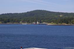 Pier and houses in the Swartz Bay as viewed from ferry to Victoria.jpg