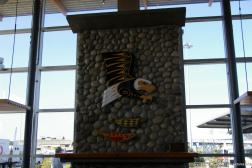 Eagle and fish carvings on the fireplace in the cafe of the BC Ferries Tsawwassen Terminal.jpg